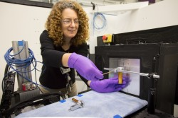 ORNL researcher Joanna McFarlane, prepares to test a sample with the IMAGING beamline at the High Flux Isotope Reactor. (Image credit: ORNL/Genevieve Martin)