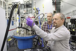Lund University professor Frederik Ossler (left) and ORNL researcher Charles Finney are using ORNL's CG-1D instrument to study biomass fuels as they pyrolyze using neutron scattering. Their research could lead to more efficient energy production from biomass. (Image credit: ORNL/Genevieve Martin)