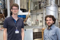 Investigating the realization of quantum spin ice, researchers Romain Sibille (left) and Nicolas Gauthier are the first users to use HYSPEC's upgraded supermirror array built by their colleagues at the Paul Scherrer Institute in Switzerland. (Image credit: ORNL/Genevieve Martin)