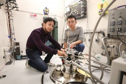 Researchers Kensuke Takechi (left) and Ruidong Yang of TRI-NA test ionic liquid samples on VISION, SNS beam line 16B, to determine the molecular dynamics and interactions of a new electrolyte. This research may lead to the development of powerful new batteries with wide-reaching applications. (Image credit: ORNL/Genevieve Martin)