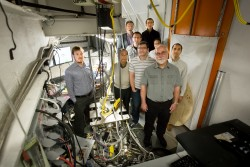A group of researchers is using neutrons to study the atomic dynamics of liquid metals is key to unlocking the mystery of the atomistic origin of viscosity. From left to right are Adam Vogt (ORNL), Takeshi Egami (UTK, JINS), Robert Ashcraft (WUSTL), Chris Pueblo (WUSTL), Mark Johnson (WUSTL), Zengquan Wang (UTK), Hui Wang (UTK), Ken Kelton (WUSTL), and Konstantin Lokshin (UTK, JINS). Image credit: Genevieve Martin/ORNL.