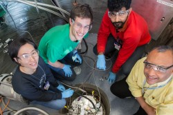 Sung Kim, Grayson Jackson and Ashish Jayaraman from the Univ. of Minnesota, and Souleymane Omar Diallo former BASIS instrument scientist, load a sample for an experiment on BASIS, SNS beam line 2. The team, led by Mahesh Mahanthappa is studying how nanoconfined water behaves in membranes, which could lead to the development of new ion transporting membranes in fuel cells and other electrochemical devices. Image credit: Genevieve Martin/ORNL