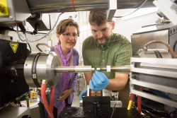 Dr. Elena Garlea, the lead scientist from the Y-12 National Security Complex, and Chris Calhoun, a PhD candidate from the University of Virginia working on the project, prepare a uranium sample for experiments at VULCAN, SNS beam line 7.