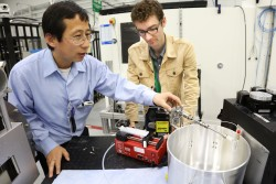 UT researchers Zhili Zhang (left) and Cary Smith, in association with researchers from the US Air Force, use neutrons at HFIR's CG-1D instrument to investigate fluid flow dynamics for potentially improved fuel systems in hypersonic vehicles and other industrial spray-related applications. (Image credit: ORNL/Genevieve Martin)