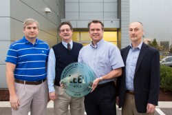From left, NScD's Mark Connell and Robert Dean, F&O's Randall Pickens of the F&O Modernization Project Office, and Associate Laboratory Director for Neutron Sciences Paul Langan.