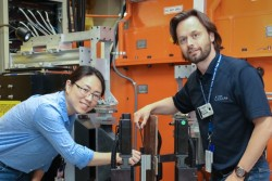 Professors Zhenzhen Yu (left) and Michael Joachim Andreassen use neutrons at HFIR's NRSF2 to investigate residual stresses expected to occur in the welds of offshore underwater wind turbine foundations. (Credit: ORNL/Genevieve Martin)