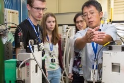 A group of NXS 2016 students learns about neutron triple-axis spectrometry from Instrument Scientist Songxue Chi. Image credit: Genevieve Martin/ORNL