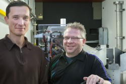 Ilia Ivanov (left) from Oak Ridge National Laboratory's Center for Nanophase Materials Science, Chris Tulk (right) from ORNL's Spallation Neutron Source and their collaborators received unexpected results from a neutron scattering experiment at SNS that could open a new pathway for the synthesis of novel materials and also help explain the formation of complex organic structures observed in interstellar space. Image credit: Genevieve Martin/ORNL