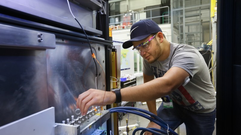 Tyler Cooksey, a graduate researcher at the University of Houston, uses ORNL's Bio-SANS instrument at the High Flux Isotope Reactor to understand how micelles can be improved to create more effective drugs. (Image credit: ORNL/Genevieve Martin)