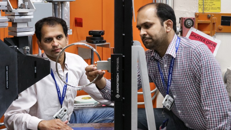 Timken researchers Vikram Bedekar (left) and Rohit Voothaluru are aiming to improve bearing manufacturing processes by using neutrons at HFIR's HB-2B. (Image credit: ORNL/Genevieve Martin)
