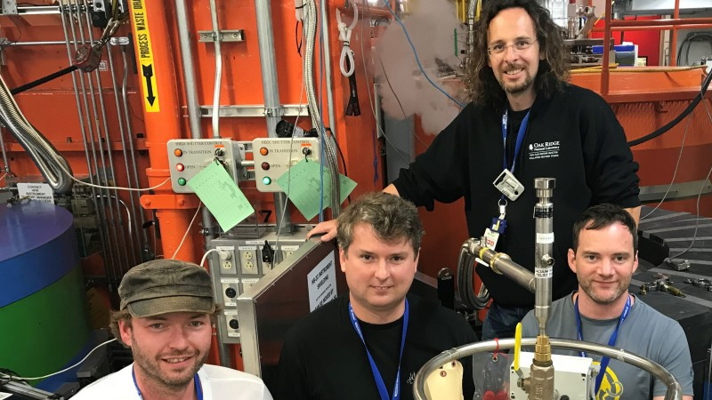 Standing at the WAND2 instrument, researchers (from left to right) Michael Heere and Yaroslav Filinchuk with ORNL beamline scientists Matthias Frontzek and Simon Kimber. (Image credit: ORNL/Jeremy Rumsey)