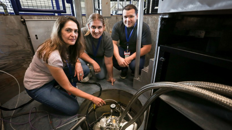 University of Copenhagen researchers Heloisa N. Bordallo, Marcella Berg, and Jose Enedilton Medeiros Pereira (left to right) are at SNS to study how cellular water behaves in cancer cells before and after treatment. They hope to determine the effects of a strong anticancer drug and establish whether water dynamics can help predict the progression of cancerous tumors. (Image credit: ORNL/Genevieve Martin)