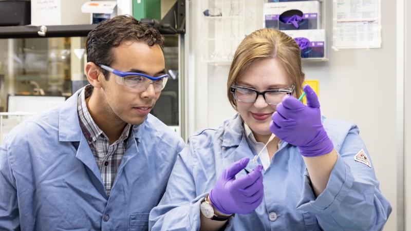 Caltech researchers Orland Bateman (left) and Rachel Ford prepare samples before using neutrons to study a novel form of mixed matrix membrane. (Credit: ORNL/Carlos Jones)