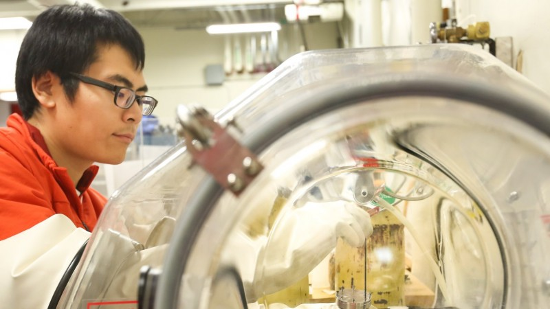 Yu Song, a researcher with the University of California–Berkeley, is shown preparing copper-doped samples of iron telluride, which were shown via neutron scattering at ORNL to have significantly altered magnetic properties. This research could help lead to faster and more efficient electrical systems and electronic devices. (Credit: ORNL/Genevieve Martin)