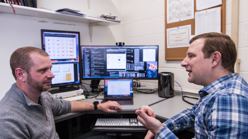 Marc Janoschek, left, and David Fobes discuss features of quantum materials. (Image Credit: Los Alamos National Laboratory)