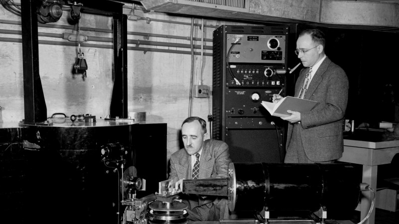 Ernest Wollan (left) and Clifford Shull work with a double-crystal neutron spectrometer at the ORNL X-10 Graphite Reactor in 1949.