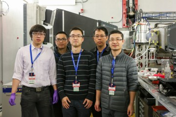 Researchers from West Virginia University used VULCAN at the Spallation Neutron Source to study materials called high-entropy oxides to develop industrial and consumer-based applications for improved energy storage and conversion. Photographed in December, 2019. Team members include (left) Wei Li, Yi Wang, Wenyuan Li, Hanchen Tian, and Zhipeng Zeng. (Credit: ORNL/Genevieve Martin)