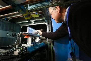 Notre Dame Professor Peter Kilpatrick making adjustments to the EQ-SANS sample loader in preparation for neutron investigation. (ORNL/Genevieve Martin)