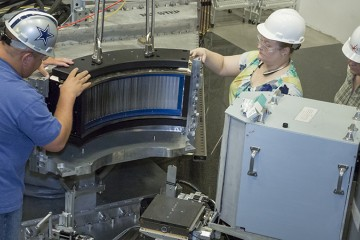 A new wide angle polarizing super mirror array at HYSPEC, SNS beam line 14B, will allow users to perform three dimensional polarization analysis of neutron excitations. Credit: Renee Manning/ORNL