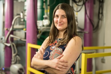 Leah Broussard leads a study of neutron decay to understand correlations between electrons and antineutrinos as well as subtle distortions in the electron energy spectrum. The physicist, who hails from Louisiana, influenced the color scheme of the experiment's newly installed instrument to reflect her home state's biggest celebration—its spectrometer sports Mardi Gras green on the magnet, purple on the shielding, and gold inside the magnet and on safety bars. Credit: Genevieve Martin/Oak Ridge National Labo