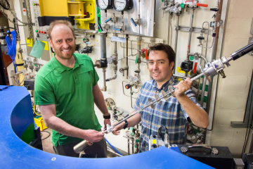 ORNL's Andrew Christianson and Stuart Calder conducted neutron diffraction studies at the lab's High Flux Isotope Reactor to clearly define the magnetic order of an osmium-based material. Image credit: ORNL/Genevieve Martin