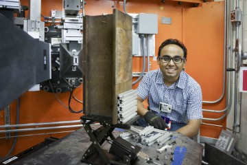 TTCI researcher Dr. Ananyo Banerjee uses HFIR's HB-2B instrument to analyze residual stresses on a worn section of rail, aiming to develop new improvements for rail reliability. (Image credit: ORNL/Genevieve Martin)
