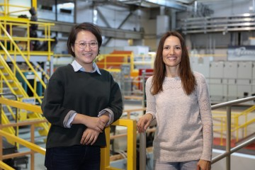 NC State University doctoral student Yue Yuan, left, recently visited the Spallation Neutron Source at Oak Ridge National Laboratory (ORNL) to explore how neutron techniques can improve her work with biocatalytic textiles. Yuan was hosted by Flora Meilleur, an ORNL structural biologist and NC State joint faculty member. Credit: ORNL/Genevieve Martin